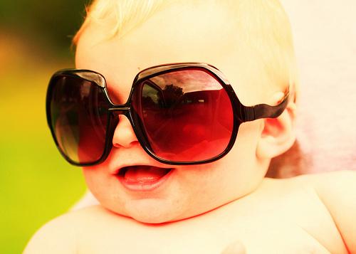 Happy Baby Wearing Big Sunglasses