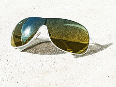Sunglasses Taking A Sunbath